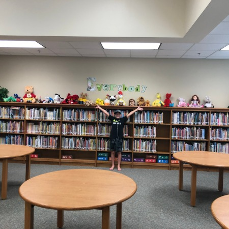 picture of school library with boy and stuffed animals
